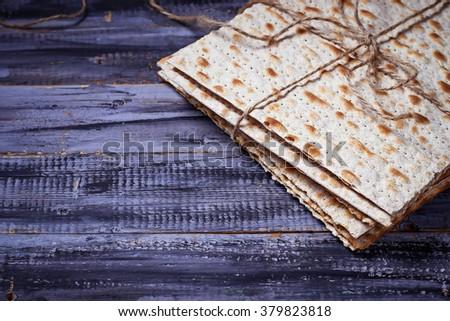 Jewish traditional Passover matzo bread.  Selective focus - stock photo