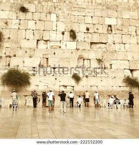 Jewish worshipers pray at the Wailing Wall. Vintage retro style - stock photo