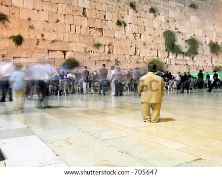 Jews are praying in front of the wailing wall in Jerusalem israel