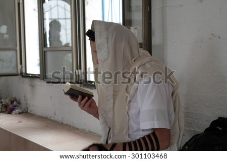 Jews pray at a holy place, a Jewish grave - stock photo