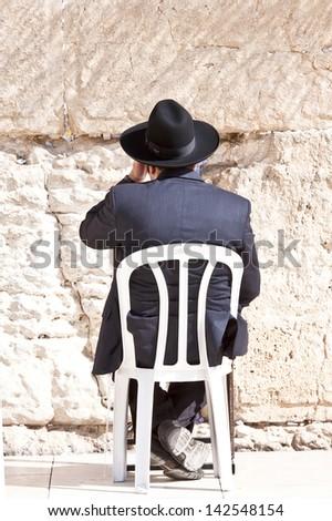 Jews praying at the Western Wall - Jerusalem - stock photo
