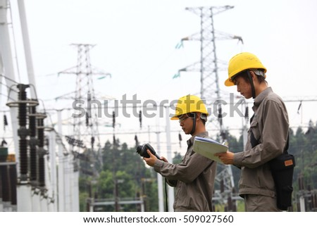 JIANGXI CHINA-August 22, 2011:220 thousand volt substation, the Chinese State Grid staff are on the power equipment routine inspection.