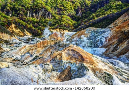 Jigokudani also known as Hell Valley is a natural source of of water for the famed hot spring resorts of Noboribetsu, Hokkaido, Japan. - stock photo