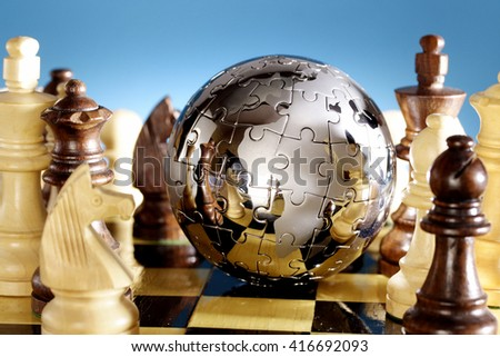 Jigsaw globe puzzle on chess board
