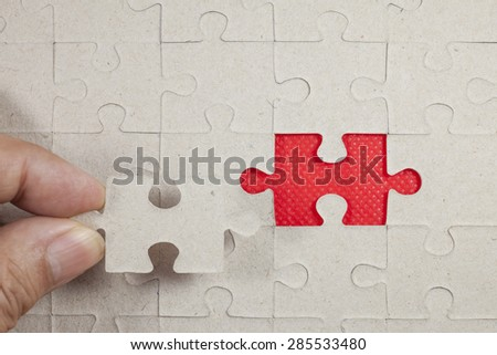 Jigsaw on red background.