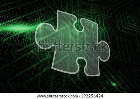 Jigsaw piece against green and black circuit board
