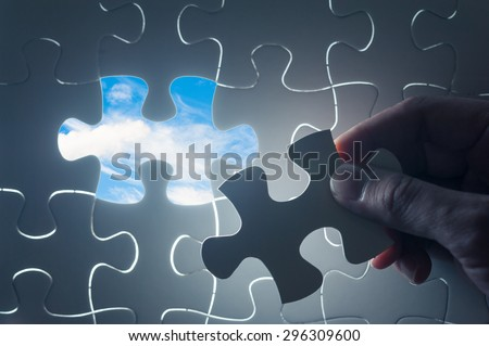 Jigsaw piece with sky in hole, conceptual image - stock photo