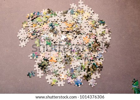 jigsaw pieces in a pile
