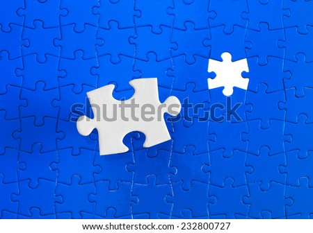 Jigsaw pieces with a blue background