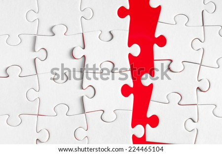 Jigsaw pieces with a red background