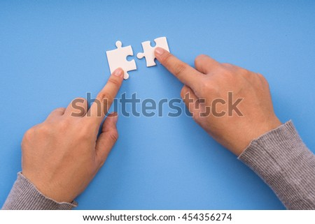 jigsaw puzzle connection, blue background - stock photo