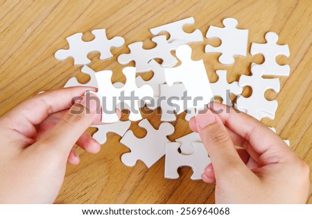 Jigsaw puzzle in hand, business background - stock photo