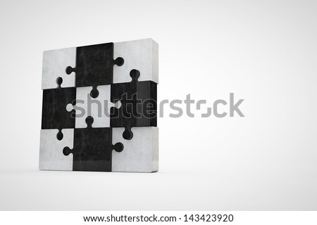 jigsaw puzzle made of dark and bright concrete - stock photo