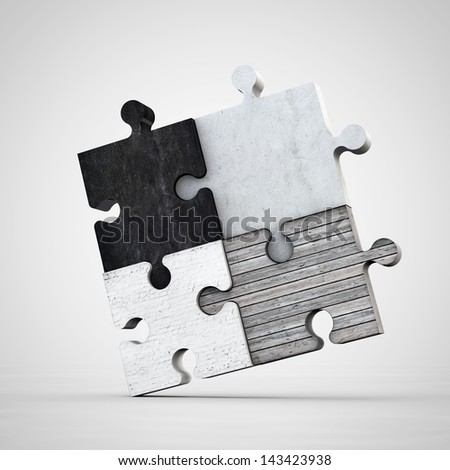 jigsaw puzzle made of different materials - stock photo