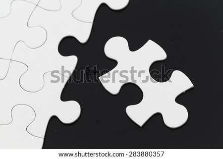 Jigsaw puzzle on black background