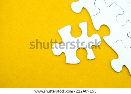 Jigsaw puzzle on recycle paper  for business concepts such as sucess, problem solution, idea, teamwork etc.
