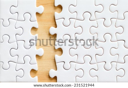 Jigsaw puzzle on wood for business concepts