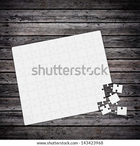 jigsaw puzzle on wood table - stock photo