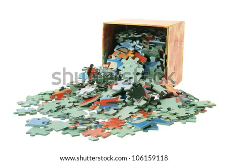 Jigsaw Puzzle Pieces and Box on White Background - stock photo