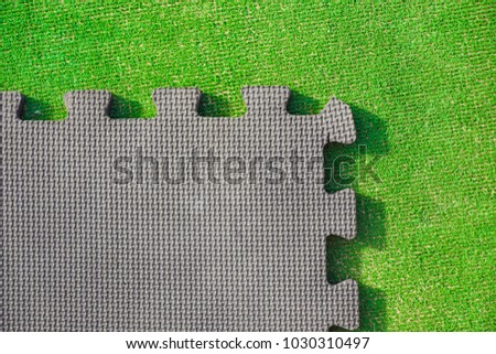 Jigsaw puzzle pieces on bright green background, horizontal view