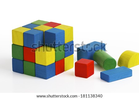 jigsaw puzzle rubik cube toy, multicolor wooden blocks colorful game, fall last element - stock photo