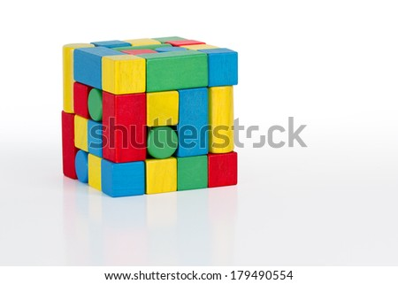 jigsaw puzzle rubik cube toy, multicolor wooden pieces, colorful game bricks over white background  - stock photo