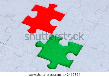 Jigsaw puzzle with a green and red gap