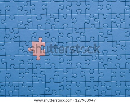Jigsaw puzzle with a missing piece.