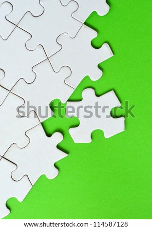 Jigsaw puzzle with space for text - stock photo