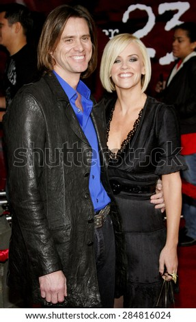 """Jim Carrey and Jenny McCarthy attend the Los Angeles Premiere of """"The Number 23"""" held at the Orpheum Theater in Los Angeles, California on February 13, 2007.  - stock photo"""