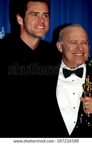 JIM CARREY with Oscar winner MICHAEL KAHN at the 1999 Academy Awards - stock photo