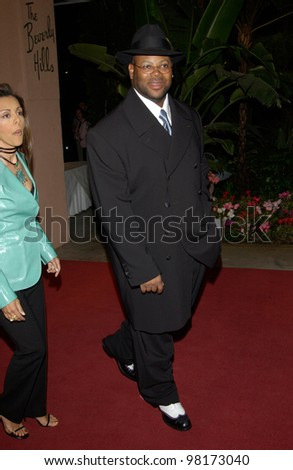 JIMMY JAM & wife LISA at pre-Grammy party given by Clive Davis of J Records at the Beverly Hills Hotel. 25FEB2002   Paul Smith / Featureflash