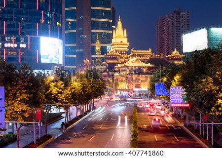 Jing'an Temple is a Buddhist temple on the West Nanjing Road in Shanghai, China. Jing'an District, where it is located, is named after the temple. - stock photo