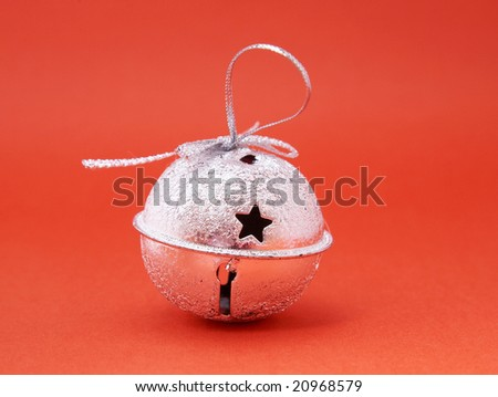jingle bell on red background. - stock photo