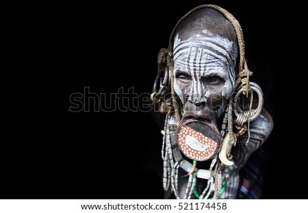 JINKA, ETHIOPIA, - 19 AUGUST 2015:unidentified women from Mursi tribe with big lip plate, in Mago National Park,. The bigger the lip plate the more the woman is considered beautiful