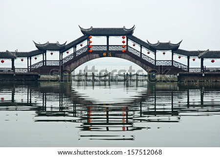 JINXI, SHANGHAI, CHINA � JANUARY 9: the antique Wenchang Pavilion to the old village at dusk. The village is a Shanghai tourist attraction with 100000 visitors per year. January 9, 2010, Jinxi, China - stock photo