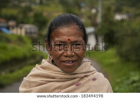 JIRI, NEPAL - CIRCA OCTOBER 2013: resident of the village of Jiri in the Himalayas circa October 2013 in Jiri. - stock photo