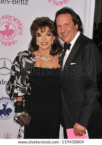 Joan Collins & husband Percy Gibson at the 26th Carousel of Hope Gala at the Beverly Hilton Hotel. October 20, 2012  Beverly Hills, CA Picture: Paul Smith - stock photo