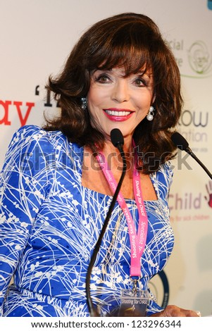 Joan Collins on the trading floor of BGC as part of the BGC Charity Day 2012, Canary Wharf, London. 11/09/2012 Picture by: Steve Vas