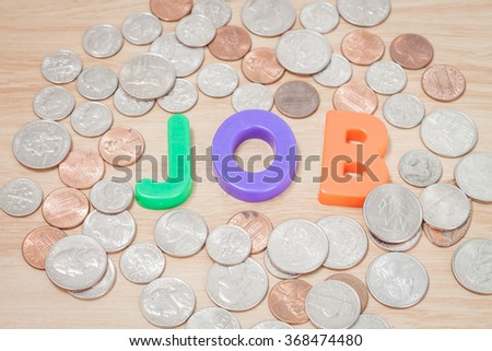 Job alphabet with various US coins, stock photo - stock photo