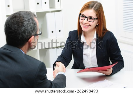 Job applicant having interview. Handshake while job interviewing - stock photo