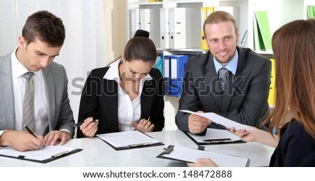 Job applicants having interview - stock photo