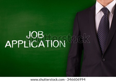 JOB APPLICATION on Blackboard with businessman - stock photo