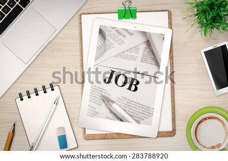 job article on office desk top view - stock photo
