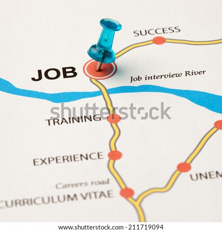 Job as target in the careers road. Conceptual image where the cities are the means that lead to the job target. Selective focus on the thumbtack. - stock photo