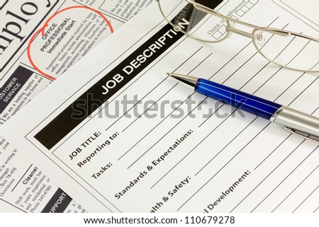 Job Description with Pen and Newspaper Ad - stock photo