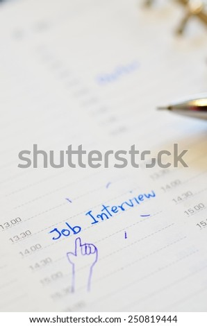 Job interview appointment on time planner - stock photo