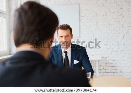 Job interview - recruiter negotiate terms with candidate - stock photo
