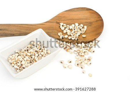 Job's tears grain seed in white bowl and spill from spoon - stock photo