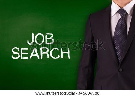 JOB SEARCH on Blackboard with businessman - stock photo